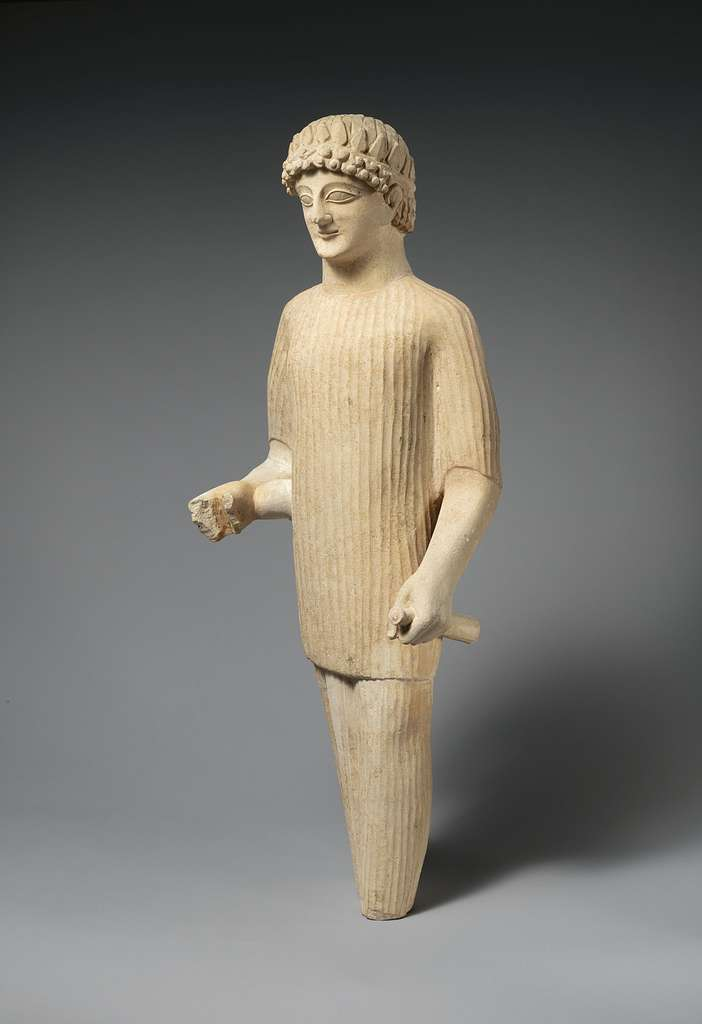 Limestone statue of a male votary wearing a wreath and long tunic