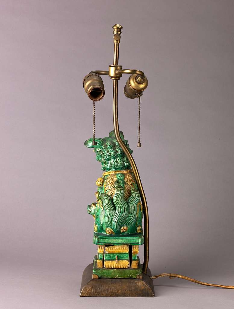 Figure of lion mounted as lamp