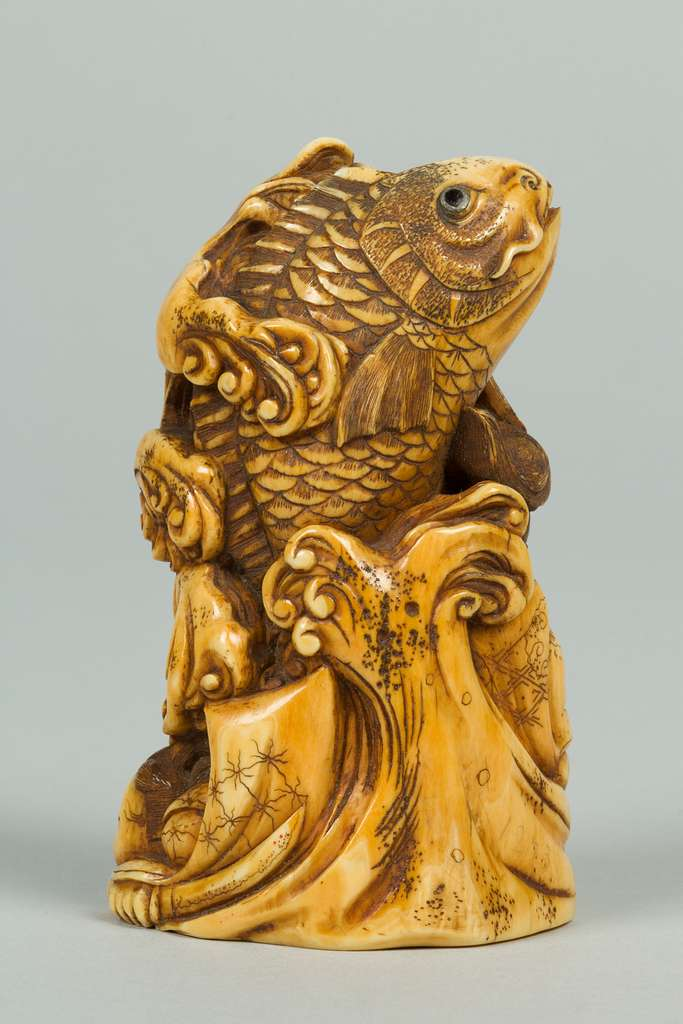 Netsuke of Group of men in the Water holding a Large Carp