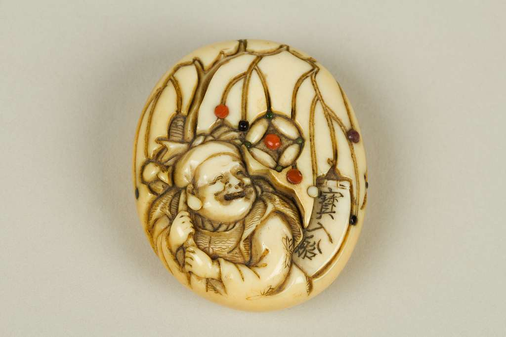 Netsuke of Hotei with Bag