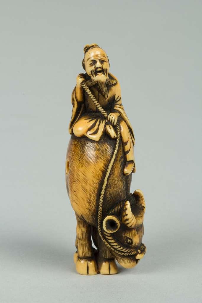 Netsuke of Man Riding a Buffalo