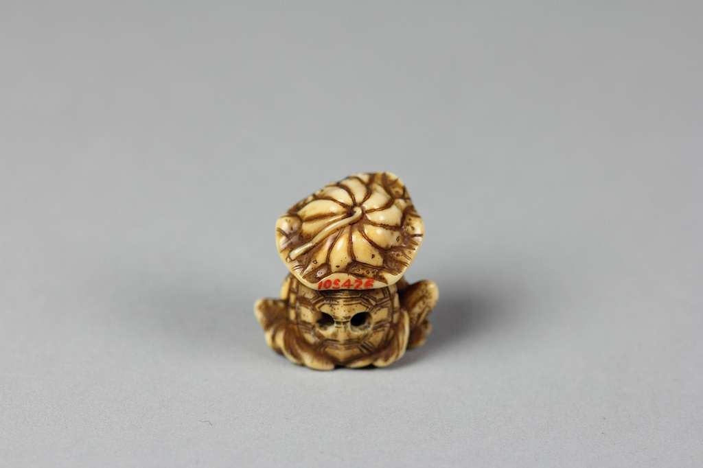 Netsuke of Monkey with Lotus Leaf Hat