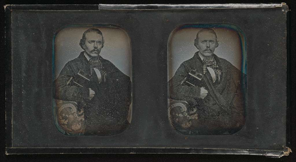 [Stereoscopic Portrait of Man Holding Stereoscopic Viewer]